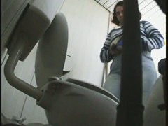 Spy toilet camera catches a sexy mature woman's pussy peeing