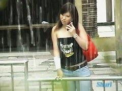 A sexy sharking asian girls nipple peek of  in public