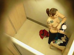 Topless tattooed asian babe caught by changing room spy cam