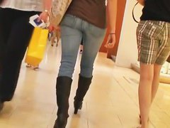 Sexy asses in tight jeans walking around clip by candid cam