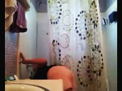 Teenage brunette on the toilet and in the shower