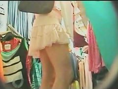 Sexy teen in a thong up skirt video from a store