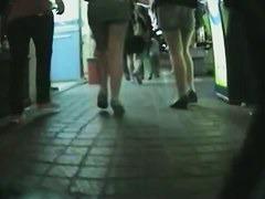 Hidden camera catching street candids of legs and butts