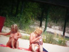 Blond chicks on the beach topless