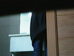 Cute babe filmed pissing by a toilet voyeur