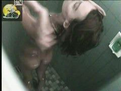 Slender brunette sweetie caught on a hidden shower cam
