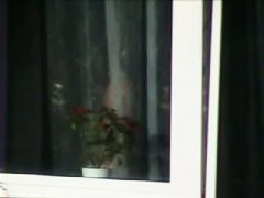 Naked mature woman caught from bedroom window by a voyeur