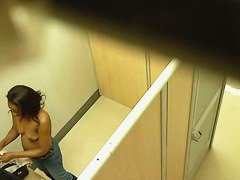 Ebony chick caught topless in the changing room