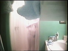An alluring bimbo caught on a spy cam in the shower