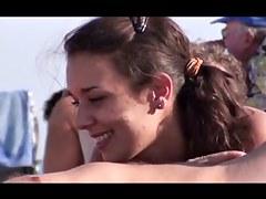 French nudist beach Cap d'Agde sexy dark brown engulfing