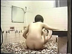 Jap girls enjoy in hidden cam lez sex video in the bathroom