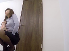 Office Lady wetting herself in the bathroom