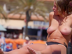 Huge natural tits on the topless beach