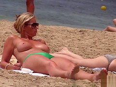 Hot MILF with huge tits on topless beach