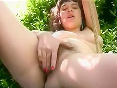 Hairy girl plays on swing