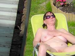 Neighbour naked sunbathing