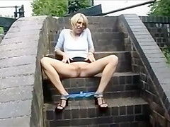 UK blonde plays by canal