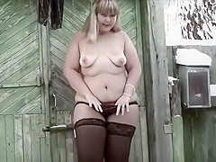 Chunky blonde plays outside