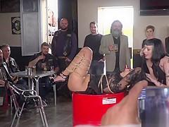 Brunette slave fucks in bikers shop