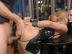 Blonde in latex anal gangbang in public