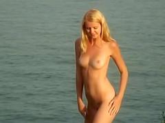 naked girls overlooking seaside