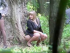 Two girls pee voyeur