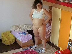 BBW lotioning herself while exposed to ip camera