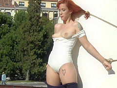 Redhead naked tied up to a storm drain