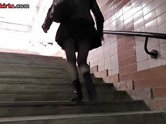 Sexy gal flashed upskirt on the stairs
