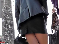 Beauty in leather petticoat lengthy legs view
