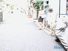 Sexy Asian girl runs for cover in a Japanese sharking video
