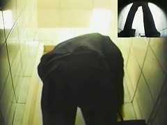 An alluring woman caught pissing on a spy cam video