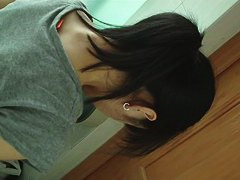 Dark haired asian chick pissing on hidden cam