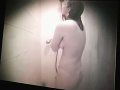 Busty dorm coed showing hairy pussy and tits in shower