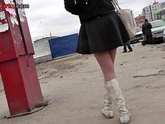 Gal in high white boots upskirt closeup