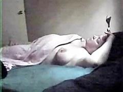 My mature mum masturbating on bed. Hidden cam