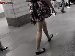 Upskirt in public with slender brunette hottie
