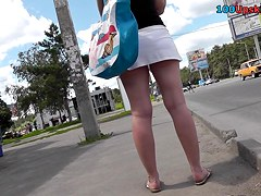 Plump blonde in white skirt and panties in upskirt clip