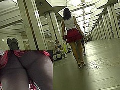 Her red skirt attracts attention of upskirt voyeur guy