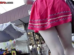 College girl's green upskirt panties and short red skirt