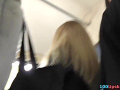 Sexy upskirts of the blonde woman going home in the bus
