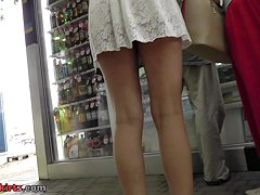 Girl walks with her gf in the amateur upskirt scene