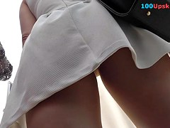 Upskirt video with girl in a-line dress and pantyhose