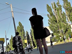 Skinny woman with dark hair caught in public upskirt