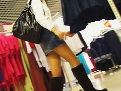 Upskirt video of a chick with white panties in the department store