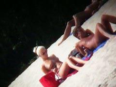 Nude beach blonde model being filmed by a voyeur