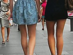 A voyeur takes upskirt shots of two extremely sexy woman breasts
