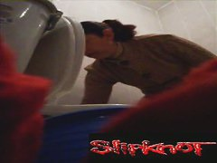 A woman takes a sensual piss while filmed by a hidden video camera