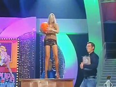 A stupid yet sexy blonde whore poorly dances on a live television show