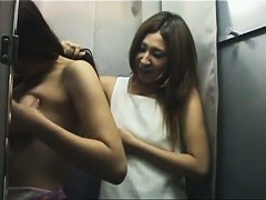 Asian girls go to the changing room to try out fake tits
